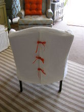 Little_white_wingback_chair_1